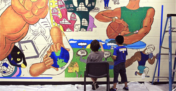 Students painting a classroom mural